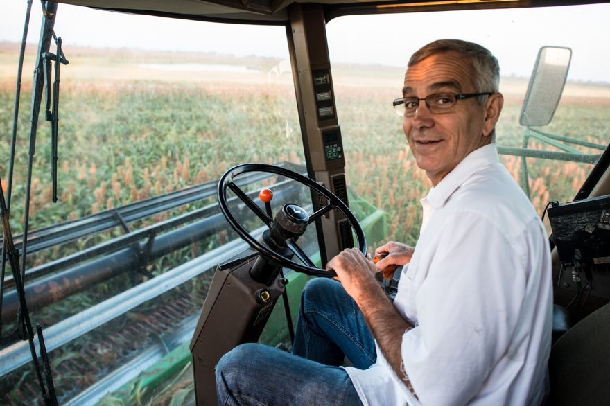 Oklahoma Secretary of Agriculture Jim Reese drives his combine while harvest milo at his farm.