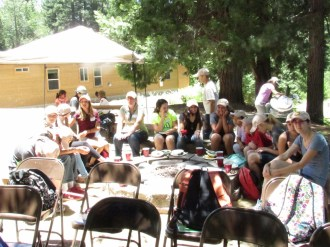 """Nature Center """"supernaturalists"""" relaxing around the fire pit"""