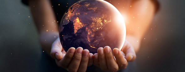 Earth at night was holding in human hands. Earth day. Energy saving concept, Elements of this image furnished by NASA Manhattan Institute | James Alexander Michie