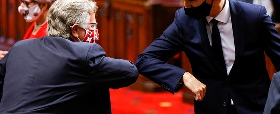 Prime Minister Justin Trudeau greets a Senator with an elbow-bump National Post | James Alexander Michie