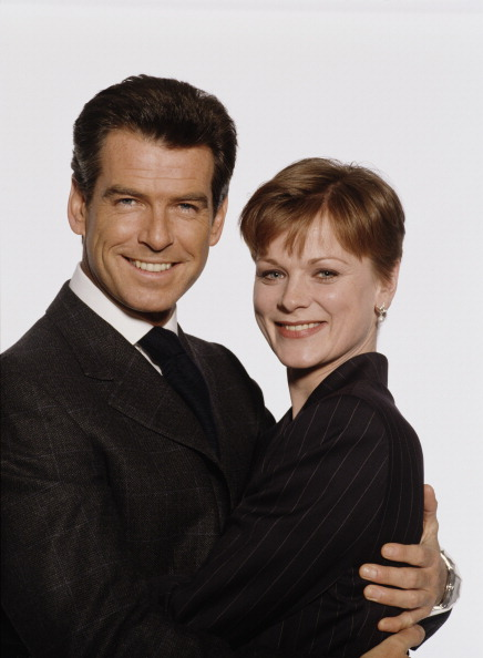 Irish actor Pierce Brosnan as 007 with actress Samantha Bond as Miss Moneypenny in a publicity still for the James Bond film 'The World Is Not Enough', 1999. (Photo by Keith Hamshere/Getty Images)