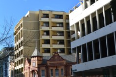 Three buildings from different eras, and yet linked. The building behind the pub doesn't overwhelm the junior, and yet also links with the Seidler-designed Australia Council building in design and lines.