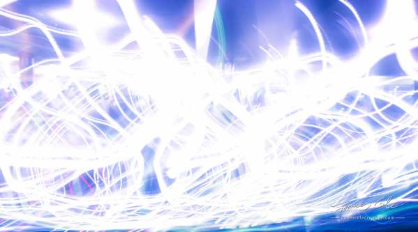 Chaotic white-blue wavy light streaks of energy and electricity 1