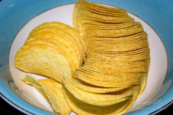A tasty bowl of salty Pringles potato chips