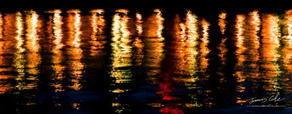 Colourful City lights reflection off the water surface
