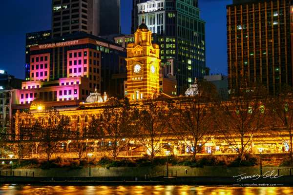 Colourful waterfront of Flinders street station historic building
