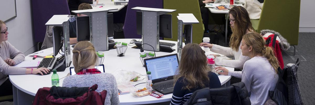 Women using computers in the JKCC at Edinburgh Napier