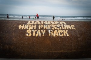 Danger High Pressure Stay Back–Rusty Old Pipe