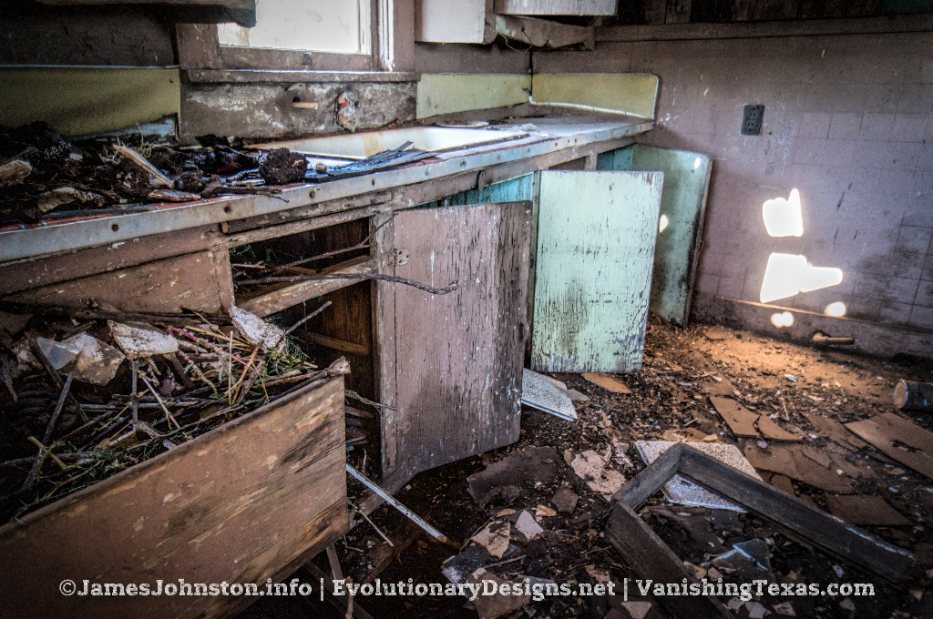 Abandoned Farm House Near Hamlin, Texas - Kitchen with rat's nests in the cabinets and drawers.