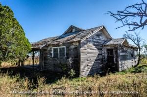 Abandoned Farm House Near Hamlin, Texas - The front is hidden from the trees.