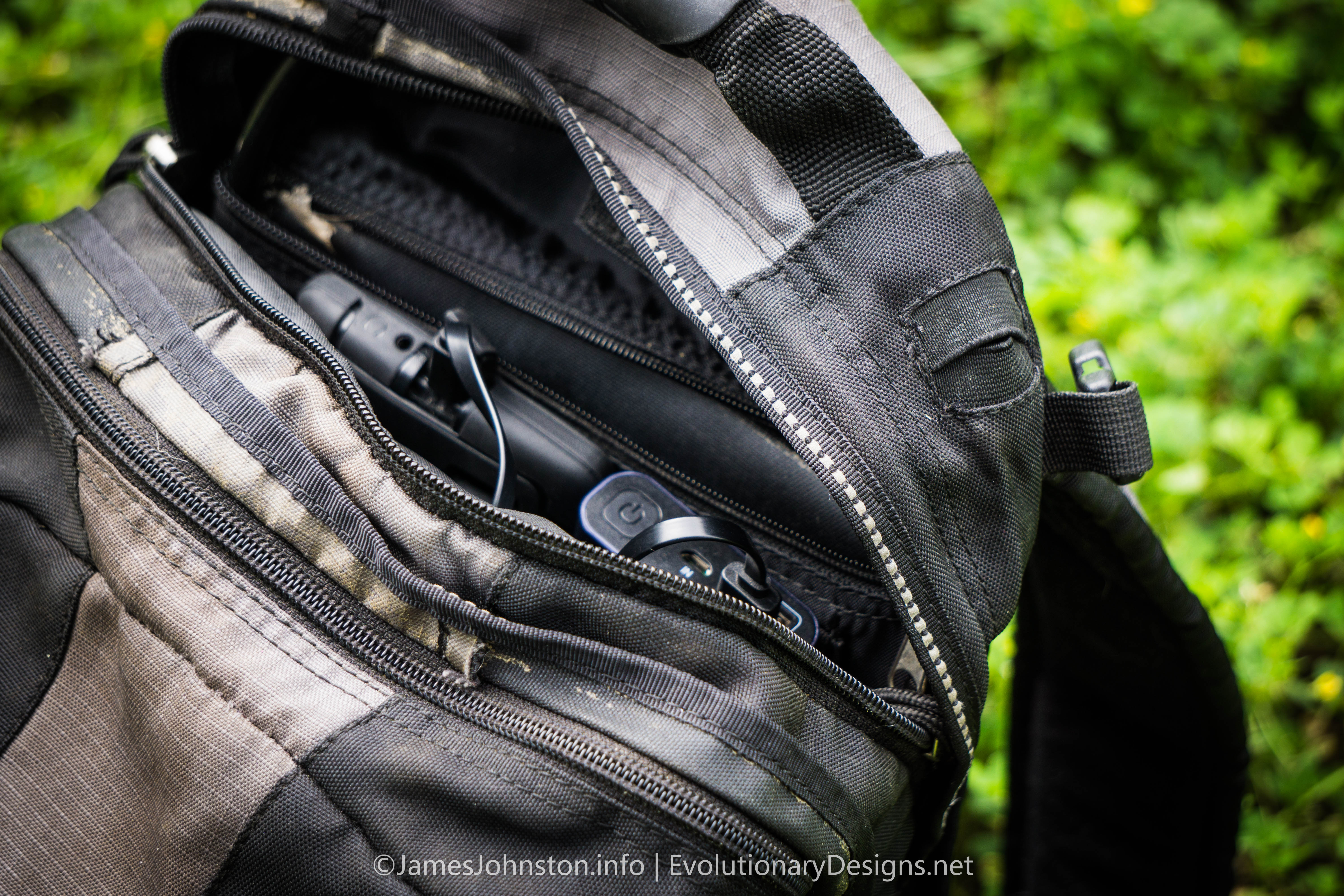 BlitzWolf BW-P5 15600mAh Quick Charge 3.0 Dual USB Power Bank charging in a small backpack pocket