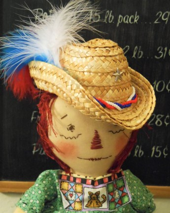 Raggedy Doll Modeling a Newly Made Hat