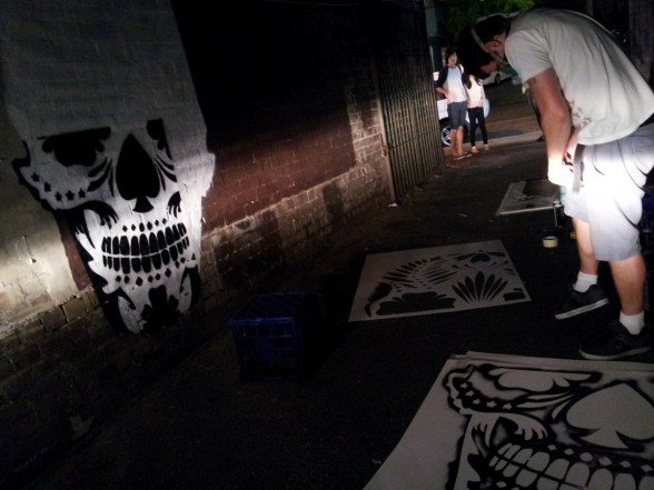 Under the headlights of a nearby vehicle, I happened upon some stencil work in progress in the lane-way between Crown Street and Wiltshire Street, Surry Hills, Sydney, Australia. It's all about the new shop next door which is opening soon, apparently.
