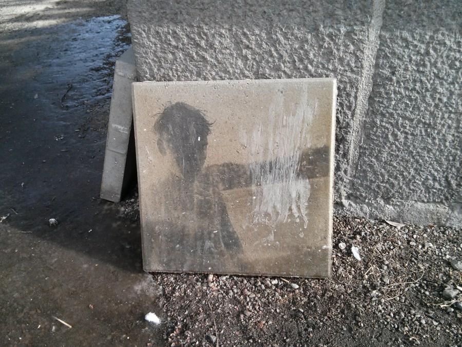 Some art on the footpath, under the bridge at Hornstulls Strand