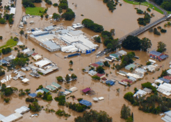 South Lismore in flood, courtesy ABC with three family homes in view.