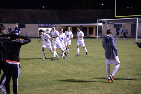 After a great win, the boys confidently run off of the field as a team.