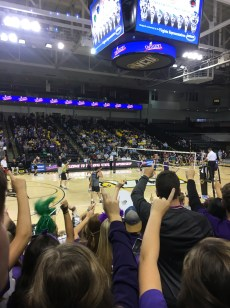 All of James River's student section holds up one finger as they wait for the last point needed before the Rapids take home the win. Photo by Mikayla Grumiaux