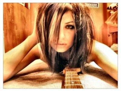 hot girl playing guitar
