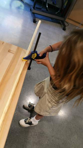 Clamping down the wood to make it secure.