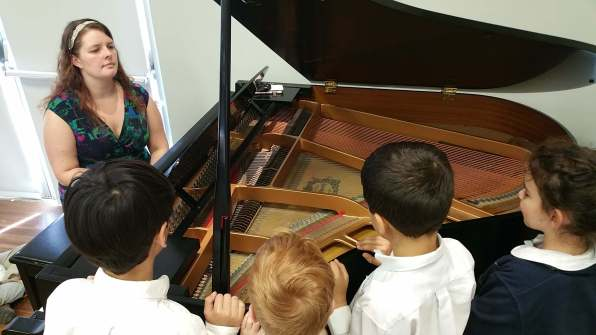 Exploring the inside of the piano.