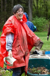 The Audubon Center & Sanctuary is inviting anyone who would like to celebrate Earth Day early this year to join them on Saturday, April 20, for Volunteer Day to make the Audubon buildings and grounds more beautiful. Pat Carlson got just a little muddy and wet while gardening at last year's event. (Photo by Jennifer Schlick)
