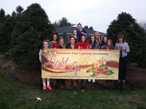 Southwestern Central School Girls Basketball team and Coach Ann Beck prepare to decorate the Light A Life trees