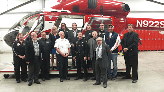 (L to R) Back row, Tammy Kinne-Gustafson, Starflight patient; Deb Weaver, Chief Flight Nurse; Dr. Michael Faulk, Starflight Medical Director; Larry Putnam, Director of Operations and Pilot in Command; Matt Ring, Flight Nurse; Front row, Jennifer Guttman, Flight Paramedic; Dan Siracuse, Star Media Group; Jim Hanson, Pilot-Second in Command; Ron Hasson, EMS Resources Manager for ALSTAR EMS; Joseph Gerace, Chautauqua County Sheriff and Starflight Board Member; Howard Howlett Jr., Starflight Board Member John Bartimole, President of WNY Healthcare Association; Gordy Overturf, Starflight Patient and David Thomas, Executive Director of W.C.A. Services Corporation.