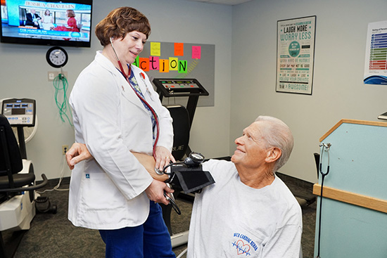 Brenda Fitzgerald, RN, WCA Hospital cardiac rehab specialist, performs a blood pressure check on Russell Cusimano, cardiac rehab patient. WCA Hospital will offer free blood pressure screenings during the month of May.