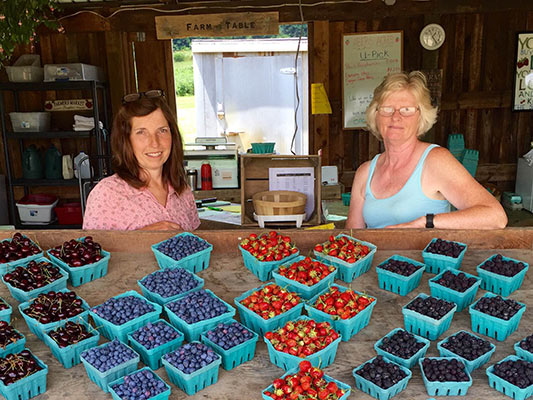 Sue Abers, co-owner of Abers Acres; Sondra Johnson, employee.