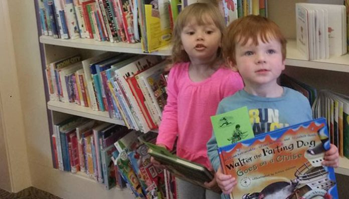 Jonah Gruber (Right) shows off a library treasure to his friend Sophia Peterson (Left). Jonah and Sophia enjoy borrowing books from the Hazeltine Public Library and are excited to take part in the Summer Reading Challenge that runs from July 5th – August 13th.