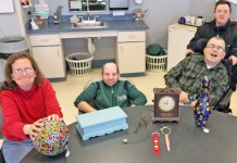 Representatives of The Resource Center pose with some of the items that will be for sale at the annual Fall Craft Bazaar on Friday, Nov. 22.