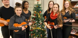 JHS Orchestra members, Adam Chang, Nicole Carlson, Iyana Sledge-Stewart, Dawnelle Walter, Sophie Schweiger and Sierra Owles prepare for the Annual Orchestra Holiday Tour.