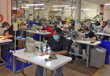 Workers sew masks at Allied Industries' Jamestown manufacturing facility.