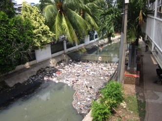 Waterways in Jakarta are often clogged with pollution