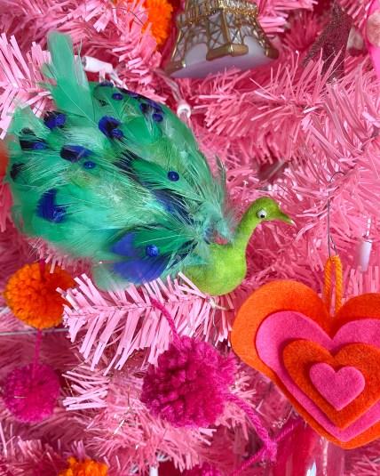 Vintage green feather bird ornament