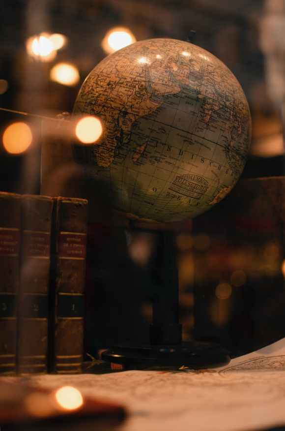 old books and globe in library