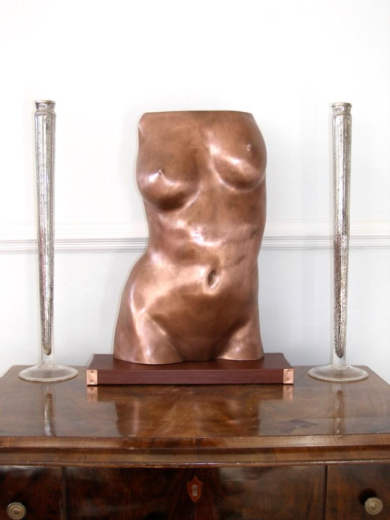 Sculpture of a female torso in cold cast copper