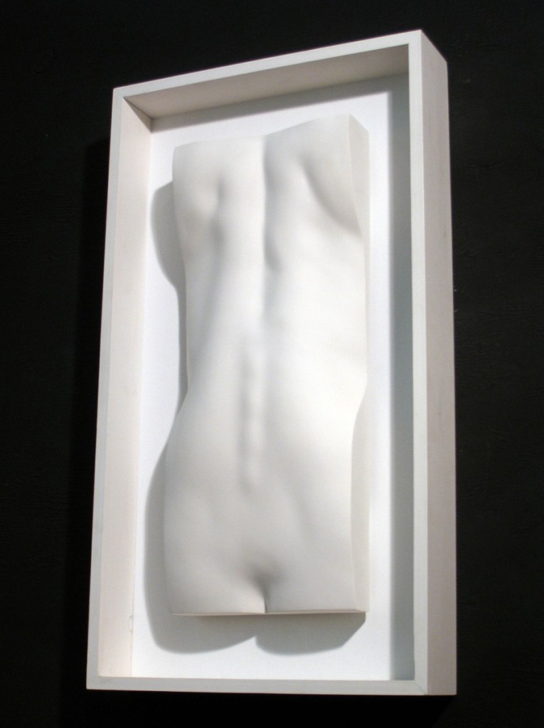 Framed female back sculpture in plaster