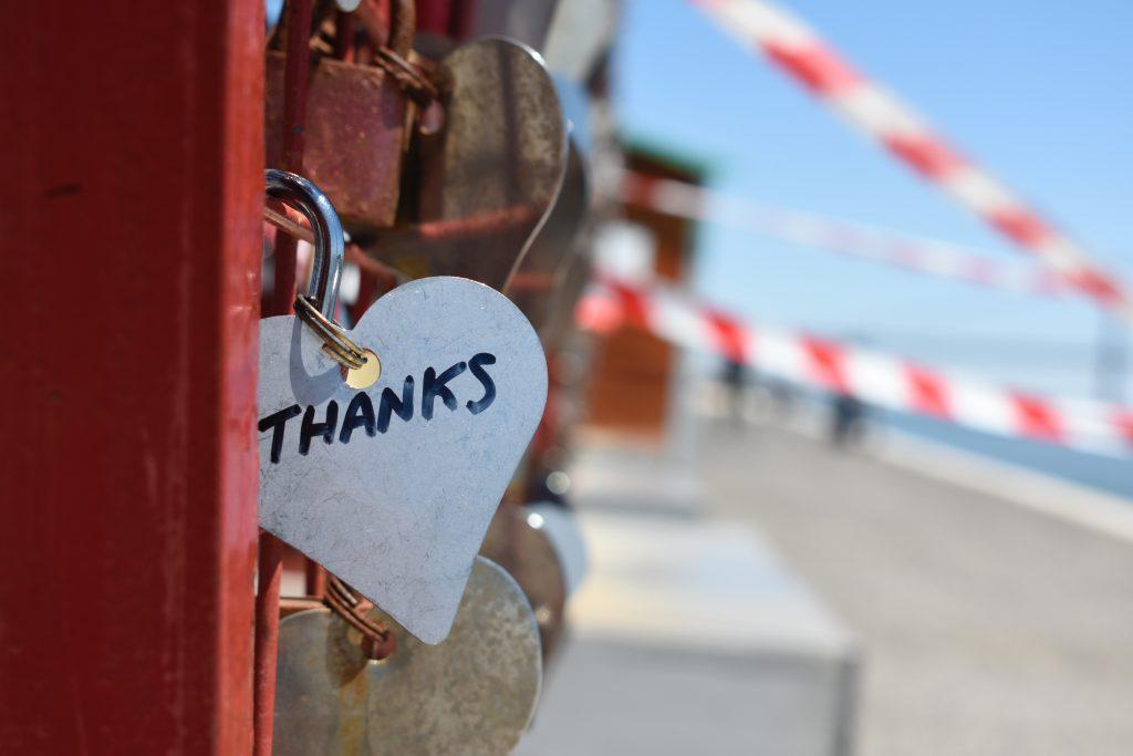 "Locket saying ""thanks"", hooked onto a bridge, symbolising gratefulness to develop mental resilience"