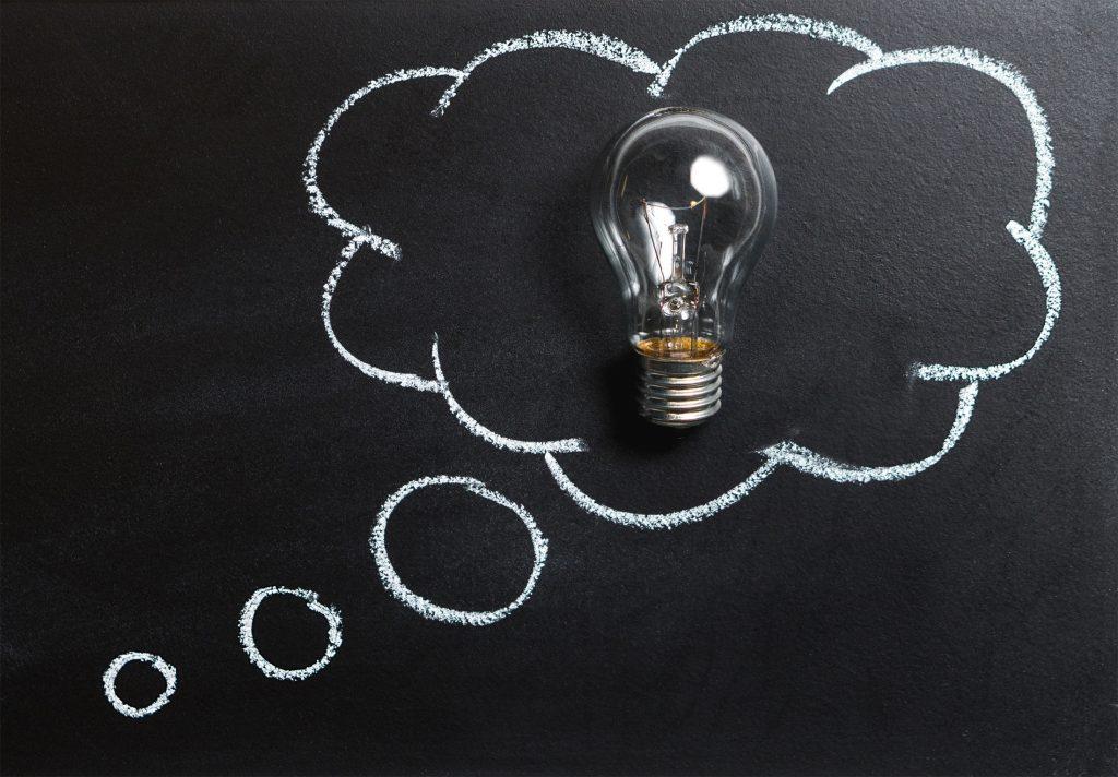 a lightbulb against a blackboard, signifying an 'idea'