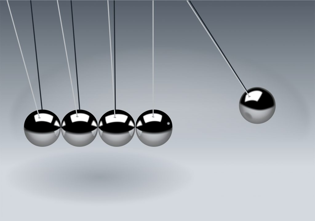 image of a newton's cradle representing repetition in business that will build growth slowly