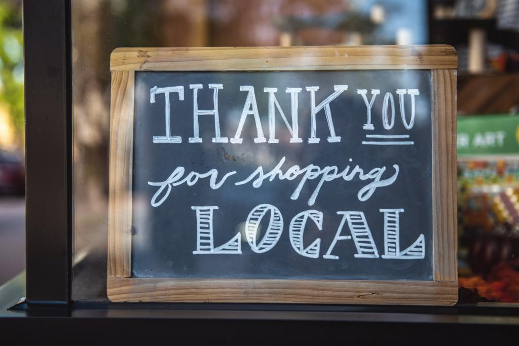 """picture of a sign in a shop window saying """"thank you for shopping local"""""""