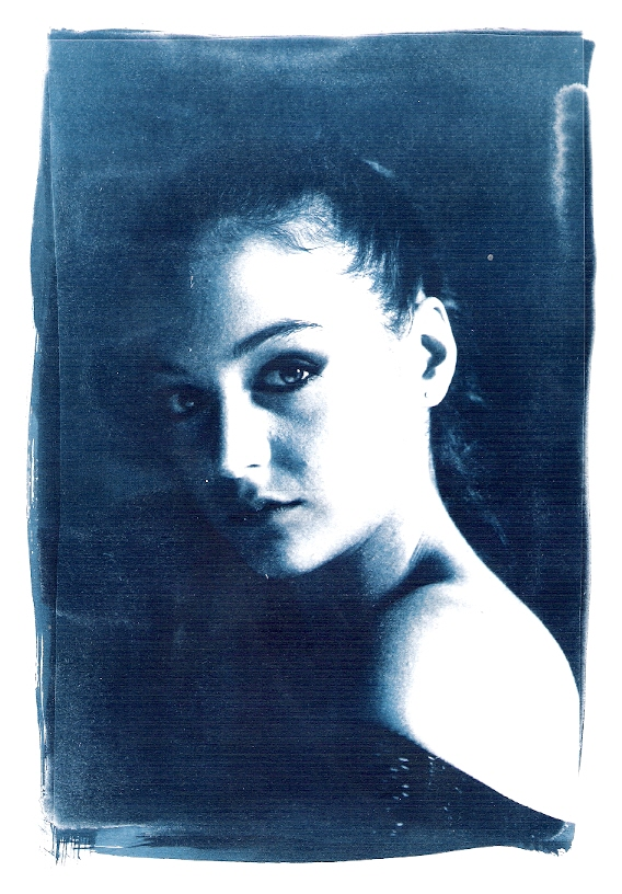 beautiful girl portrait print with the ancient technique of cyanotype