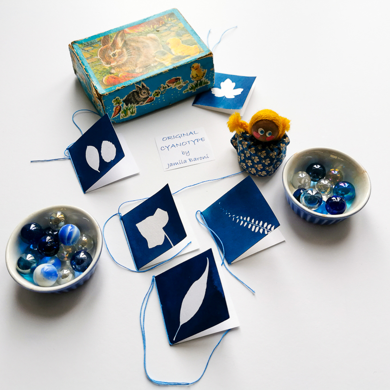small cards printing with the ancient technique of cyanotype and some small toys