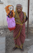 Lalanbai, one of CRHP's first five Village Health Workers, holds a puppet that is used by the Mobile Health Team and Village Health Workers.