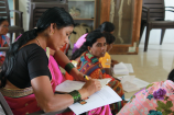 Asha, a Village Health Worker, sits in a class to learn about different ways to identify inner ear problems.