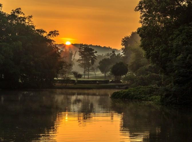 The sun rises over a misty Royal Chiang Mai Golf Club