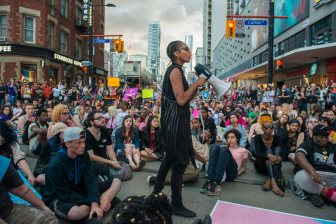 Black Lives Matter activist Janaya Khan organizes a sit-in at Yonge st. and College st. during the Trans Pride March, in Toronto on Friday July 1 , 2016. THE CANADIAN PRESS/Eduardo Lima