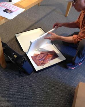 Saul unpacks carefully