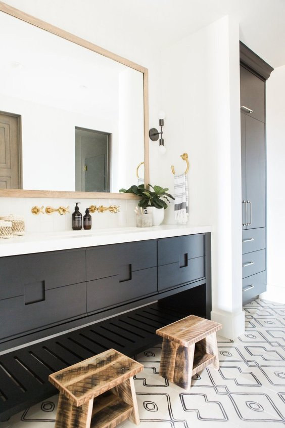 Beautiful modern bathroom design with dark vanity cabinet color and patterned black and white tile floor - Promontory Project - Studiio McGee - bathroom ideas - bathroom decor - small bathroom ideas - bathroom remodel
